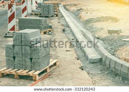 Sidewalk under construction, curb and gutter installation in progress. Shallow dof and vintage style. - stock photo