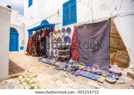 Sidi Bou Said - multicolor sovenir earthenware in tunisian market, Tunisia - stock photo
