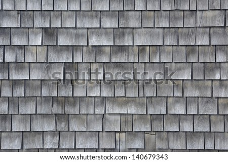 Siding of gray wood shingles with low environmental impact on house in Cape Cod, Massachusetts - stock photo