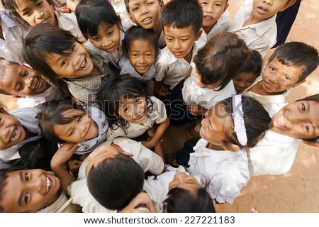 SIEM REAP, CAMBODIA, DECEMBER 04, 2012: group of joyful kids posing in a schoolyard in Siem Reap, Cambodia - stock photo