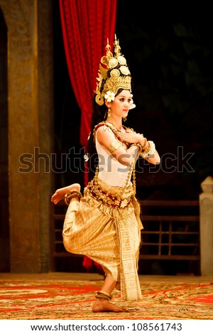 SIEM REAP, CAMBODIA - DECEMBER 28, 2008: Khmer classical dancer performing in full traditional costume December 28, 2008 in Siem Reap, Cambodia.Angkor Wat is the most visited place in Cambodia. - stock photo