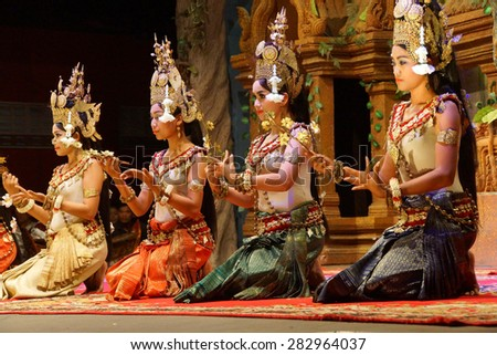 SIEM REAP, CAMBODIA - FEB 14, 2015 - Apsara dancers kneel at the end of a performance, Siem Reap,  Cambodia - stock photo
