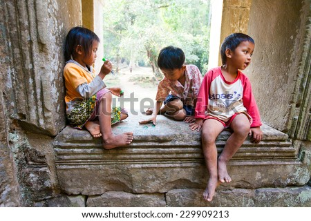 SIEM REAP, CAMBODIA- FEBRUARY 4, 2014: A group of unidentified  children playing - stock photo