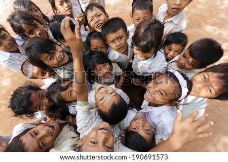 SIEM REAP -DECEMBER 04: group of joyful kids posing in a schoolyard on December 04, 2012 in Siem Reap, Cambodia - stock photo