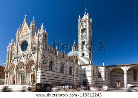 Siena cathedral against a bright blue sky in Italy - stock photo
