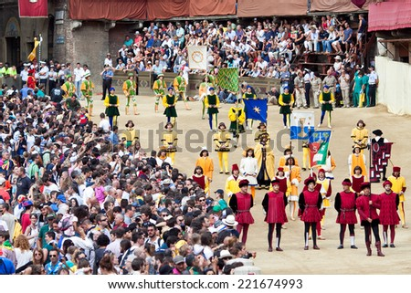 "SIENA, ITALY - AUGUST 16: Parade before start of annual traditional Palio di Siena horse race in medieval square ""Piazza del Campo"" August 16, 2014 in Siena, Italy - stock photo"