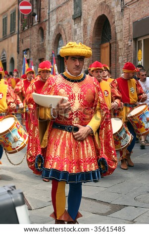 SIENA, ITALY - JULY 2: The contrada of Chioccola parade through the streets of Siena in preparation for the Palio July 2, 2009 in Siena, Italy. - stock photo