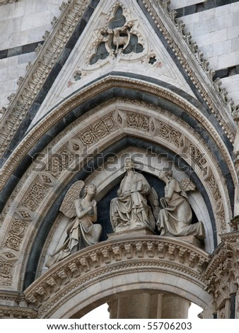 Siena - the portal to the lateral wall of the unfinished Duomo Nuovo - stock photo