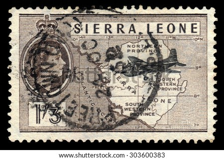 SIERRA LEONE - CIRCA 1956: a stamp printed in Sierra Leone shows plane on a background map of Sierra Leone, circa 1956 - stock photo
