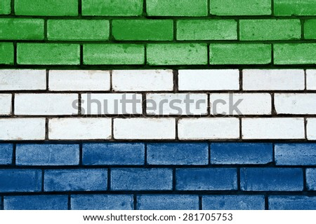 Sierra Leone flag painted on old brick wall texture background - stock photo