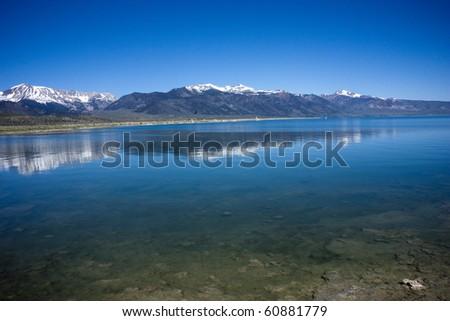 Sierra Nevada Peaks Reflecting on Mono Lake - stock photo