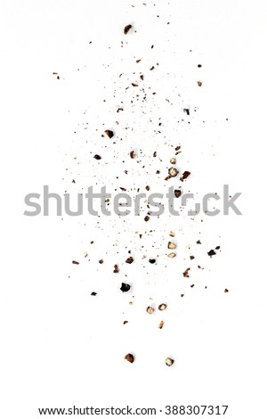 Sifting heavy ground black pepper over white background. - stock photo