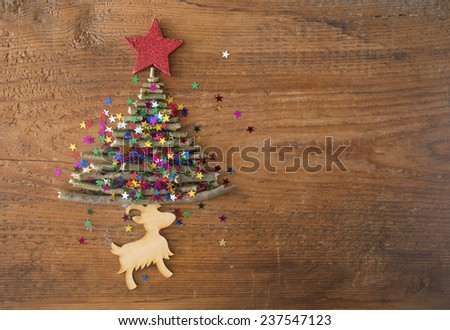 Sigh symbol from many dry Stick Christmas Tree a lot colorful star toys on old retro vintage style wooden texture background Empty copy space for inscription Idea merry new year holiday year of Goat - stock photo