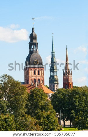 Sights of Riga - Dome Cathedral, the Church of St. Peter and the Anglican Church  - stock photo