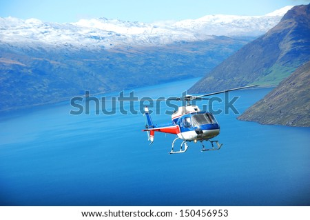 Sightseeing Helicopter in Queenstown - stock photo
