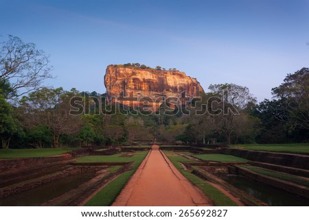 Sigiriya. Lion's rock at sunset, Place with a large stone and ancient rock fortress and palace ruin. Srilanka, Asia - stock photo