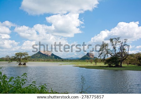 Sigiriya Rock Fortress And Pidurangala Rock View From Thalkote Lake. Sigiriya Is  5th Centurys Ruined Castle That Is Unesco Listed As A World Heritage Site In Sri Lanka - stock photo