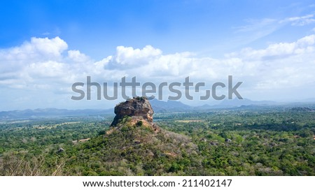 Sigiriya Rock Fortress View From Pidurangala Rock. Sigiriya Rock Fortress, 5th Century's Ruined Castle That Is Unesco Listed As A World Heritage Site In Sri Lanka - stock photo