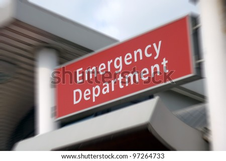 Sign above the Emergency Department in NHS hospital. Zoom effect centered on sign. - stock photo