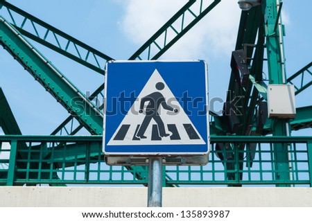 Sign across the road, isolated on white with clipping path. - stock photo