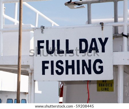 Sign advertising a fishing charter - stock photo