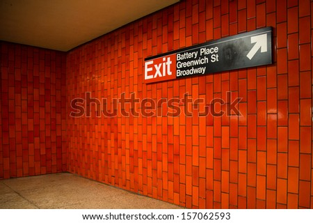 Sign and red tiles in downtown New York City Subway  - stock photo