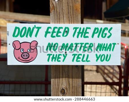 Sign at petting zoo rural Georgia, USA. - stock photo