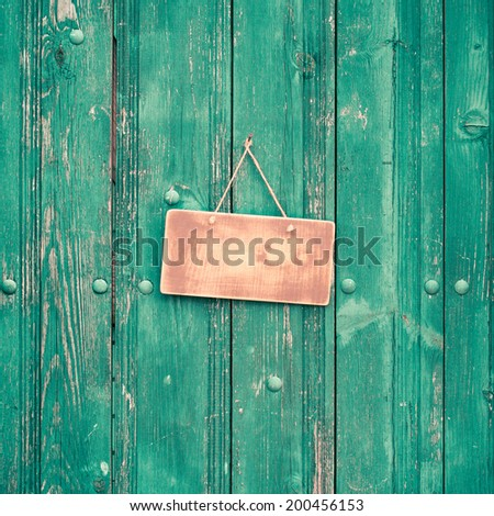 Sign board blank on vintage mint green wooden planks wall background - stock photo