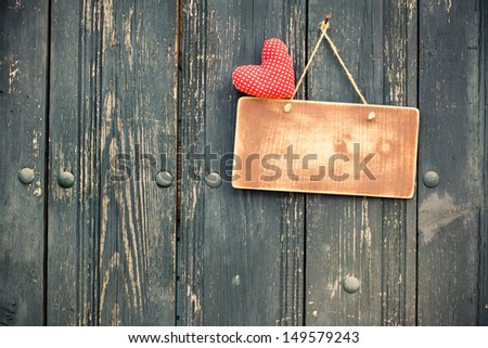 Sign board, love heart, hanging on vintage wood background - stock photo