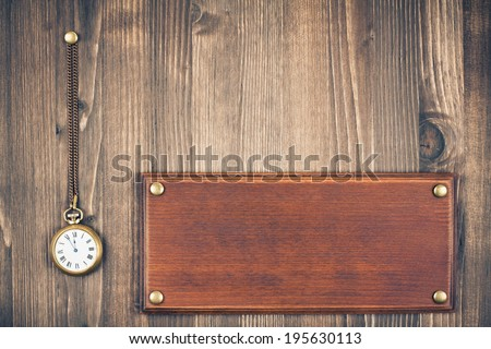 Sign board, pocket watches on wooden wall background - stock photo