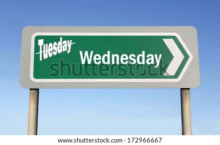 Sign depicting the change from Tuesday to Wednesday, with the word Tuesday crossed out - stock photo