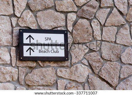 sign directing to the spa and beach club - stock photo