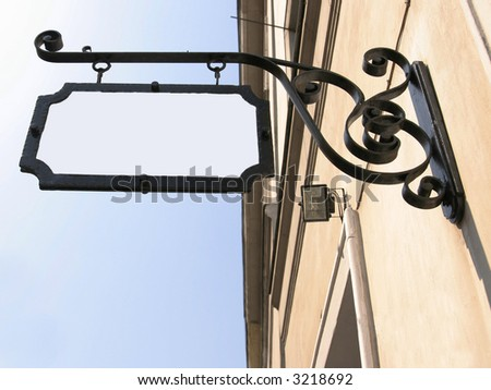 sign henging on a wall - stock photo