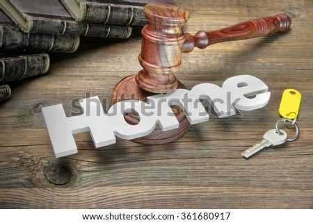 Sign Home, Door Key, Judges Or Auctioneer Gavel And Old Law Book On The Wood Table. Concept For Trial, Bankruptcy, Tax, Mortgage,  Auction Bidding, Foreclosure Or Inherit Real Estate - stock photo