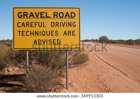 "Sign in outback Australia that reads ""Careful Driving Techniques are Advised""   - stock photo"