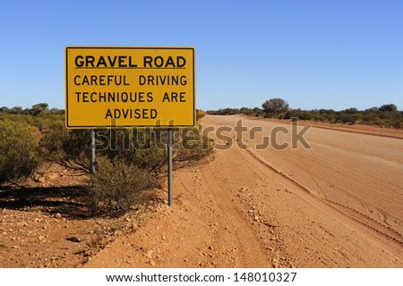 "Sign in outback Australia that reads ""Carful Driving Techniques are Advised"" - stock photo"
