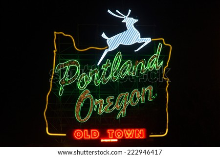 Sign in Portland, Oregon with jumping deer and image of oregon's borders - stock photo
