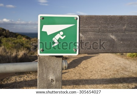 Sign indicating a paragliding launching site near Bells Beach, Victoria, Australia - stock photo