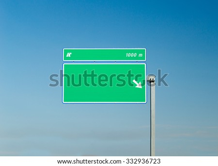 sign isolated on a highway with sky backgraund - stock photo