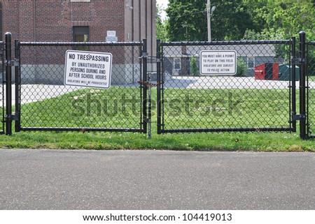 Sign No Trespassing School Property Fence No Skate Boarding - stock photo