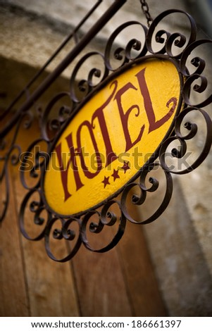 Sign of an old charming hotel in France - stock photo