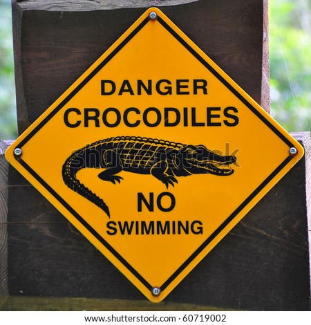 Sign of danger crocodiles - stock photo