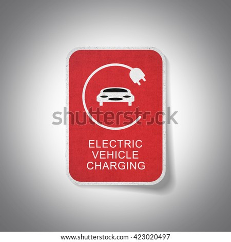Sign of electric vehicle charging - stock photo