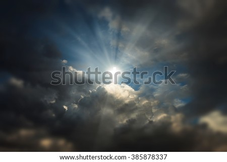 Sign of faith. Glowing holy cross in the sky - stock photo