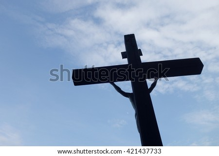 Sign of faith. Wooden cross in a cloudy sky - stock photo