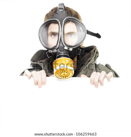 Sign of pollution and terror with a male army soldier wearing military gas mask holding blank empty copy space board in a place your notice of protest here - stock photo