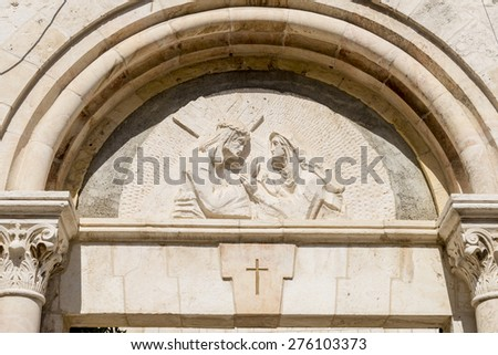 Sign of worship of Christians on the Via Dolorosa in Jerusalem - stock photo