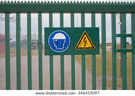 sign on fence high voltage - stock photo