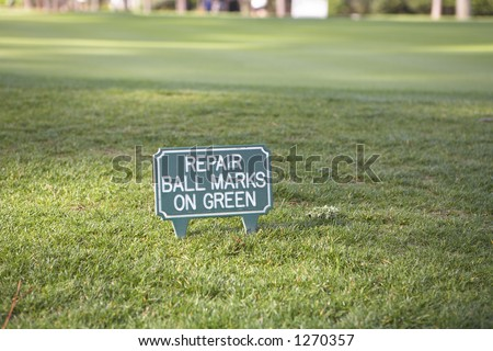 Sign on golf course - stock photo