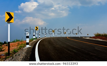 Sign on road in countryside of tropical country - stock photo